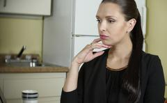 Sad depressed business woman at home thinking - selective focus on face - stock photo