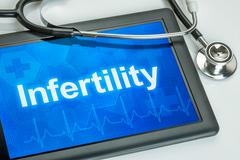 Tablet with the diagnosis Infertility on the display - stock photo