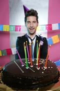 Holiday party chocolate cake in young man hands - stock photo