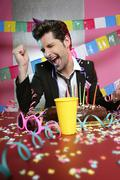 Happy gesture man in holiday party - stock photo