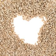 Hearth shaped sunflower seeds frame - stock photo