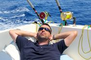 Sailor man fishing resting in boat summer vacation Stock Photos