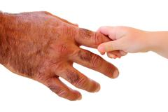 little kid hand holding hairy father big hand - stock photo