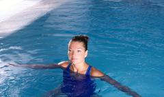 blue pool woman beautiful swimming in water - stock photo