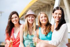 girls with drinks on the beach - stock photo