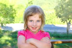 Blond little girl portratit happy smiling facing camera Stock Photos