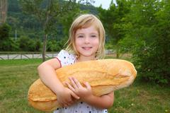 girl holding big bread humor size hungry child - stock photo