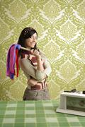 retro housewife cleaning duster woman sixties - stock photo