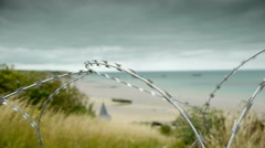 Barbed wire at memorial beach at Arromanches, France Stock Footage