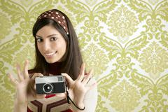 Retro photo camera woman green sixties wallpaper - stock photo