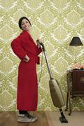 Bathrobe retro housewife woman vacuum cleaner Stock Photos