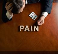 Word Pain and devastated man composition - stock illustration