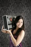 Retro open reel tape recorder beautiful brunette Dj Stock Photos