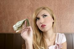 Stock Photo of ambition retro woman lots of dollar money notes