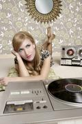 Audiophile retro woman vinyl turntable music Stock Photos