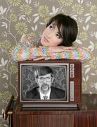 Retro woman in love with tv nerd hero Stock Photos