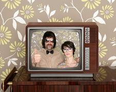 wood old tv nerd silly couple retro man woman - stock photo