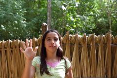 Indian girl waving greeting in jungle south american - stock photo