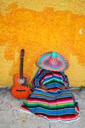 Mexican typical lazy man sombrero hat guitar serape Stock Photos