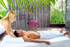 Cranial sacral massage therapy in Jungle cabin Stock Photos