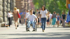 Edc2 in 1 video! Woman walk and take disabled man's hand (man is in wheelchair) Stock Footage