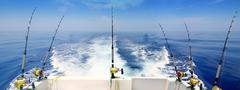 boat fishing trolling panoramic rod and reels blue sea - stock photo