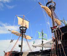 Pirates boats mast sailboat poles over blue sky Stock Photos