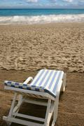 Beach hammock sand vacation metaphor Stock Photos