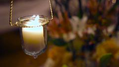 Candle To Flowers Rack Focus Stock Footage