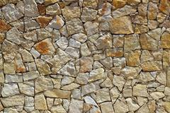 Stock Photo of masonry stone wall rock construction pattern