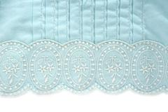 Embroidery truquoise fabric white flower design Stock Photos