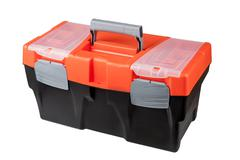 New modern closed toolbox black plastic, with an orange top. - stock photo