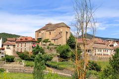 Hecho village Pyrenees with Romanesque church - stock photo