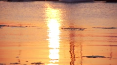 Sunset path in orange in the sea with small waves in slow motion Stock Footage