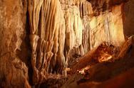 Cave stalactites underground cavern magic light Stock Photos