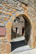 Ainsa medieval romanesque village arch fort door - stock photo