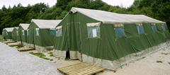 Stock Photo of Green tent camp in Pyrenees for  Santiago pilgrims