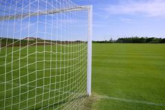 Net soccer goal football green grass field Stock Photos