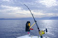 Downrigger boat gear saltwater trolling tackle - stock photo