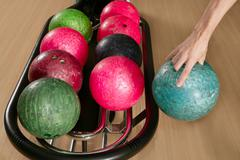 Bowling ball in player man hand - stock photo