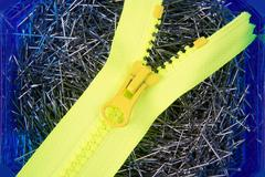 Dressmaker pins background with yellow zip Stock Photos