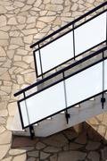 glass banisters stairway with masonry floor - stock photo