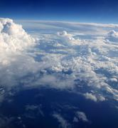 blue sky clouds view from aircarft airplane - stock photo