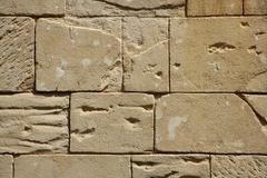 Big rectangle masonry stones on a wall - stock photo
