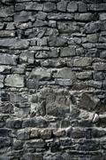Stock Photo of Antique grunge old gray stone wall masonry