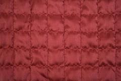 Red fabric texture with sewing square pattern Stock Photos