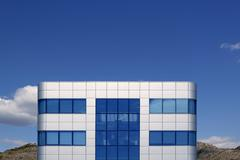 Blue glass and silver cubic architecture building Stock Photos