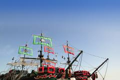 Pirates boats cut image with blue sky over Stock Photos