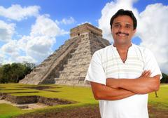 Mexican man with mayan shirt smiling - stock photo