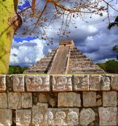 Chichen Itza Tzompantli Wall of Skulls Kukulkan pyramid - stock photo
